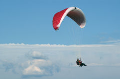 Tandem paragliding high in clouds Stock Photos