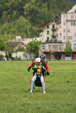 Tandem paragliding landing after flight over the Swiss Alps in Interlaken, Switzerland Stock Images