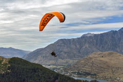 Tandem paragliding over Lake Wakatipu in Queenstown, New Zealand Royalty Free Stock Image