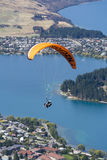 Tandem paragliding over Lake Wakatipu in Queenstown, New Zealand Royalty Free Stock Photography