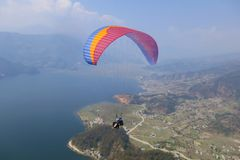 Tandem paragliding in Nepal stock photography