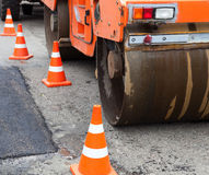Tandem road roller and traffic cones on the road construction Stock Image