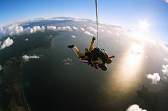 Tandem Skydive. Two people skydiving in tandem from an aeroplane Royalty Free Stock Photos