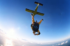 Tandem Skydive. Two people skydiving in tandem from an aeroplane Stock Photos