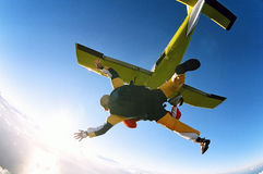 Tandem skydive. Man and woman skydiving in tandem from an aircraft Stock Photo