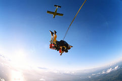 Tandem skydive. Man and woman skydiving in tandem from an aircraft Royalty Free Stock Photo