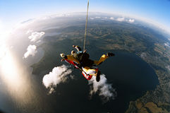 Tandem skydive. Man and woman skydiving in tandem from an aircraft Royalty Free Stock Images