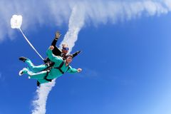 Tandem skydive. Skydive instructor and his student flying in the sky after jump from the airplane Royalty Free Stock Images