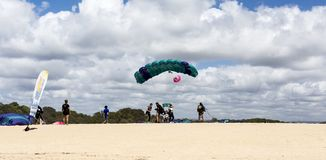 Tandem Skydive Landing on the Beach. Tandem skydive is the awesome rush of exhilarating freefall after leaping out of a plane to land on the beach, in Queensland stock photos