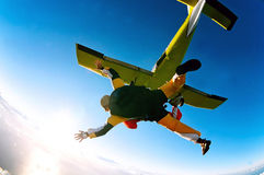 Tandem skydivers in action. Tandem skydiver in action parachuting, seen in mid air position Stock Photography