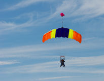 Tandem Skydiving. Tandem skydivers on colorful parachute Stock Images