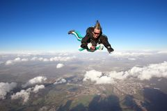 Tandem skydiving. Skydiving instructor and his client enjoying tandem skydiving Royalty Free Stock Photography