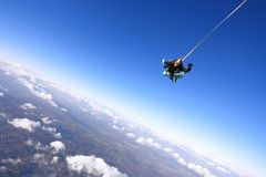 Tandem skydiving. Skydiving instructor and his client enjoying tandem skydiving Royalty Free Stock Images
