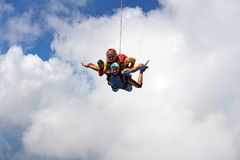 Tandem skydiving. Instructor with sexy girl. royalty free stock image