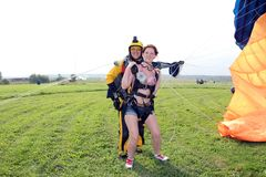 Skydiving. Tandem have just landed. royalty free stock photo