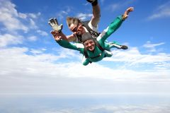 Tandem skydiving. Skydiving instructor and his client enjoying tandem skydiving stock images