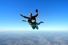 Tandem skydiving. Skydiving instructor and his client enjoying tandem skydiving Stock Photos