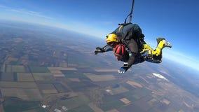 Tandem Skydiving. Tandem Jump. Parachutists in Long Free Fall. Mayskoe, Dnepr, Oktober 14, 2018: Tandem Skydiving. Tandem Jump. Parachutists in Long Free Fall stock footage