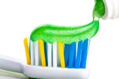 Tandenborstel en tandpasta stock foto's