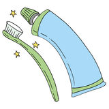 Tandenborstel en tandpastabuis Stock Afbeelding