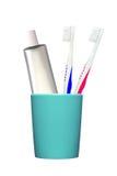 Tandenborstels en tandpasta in glas op wit wordt geïsoleerd dat Stock Foto's