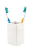 Tandenborstels in kop Stock Foto's
