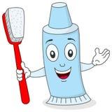 Tandkräm med tandborsteteckenet Arkivbild