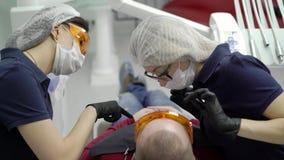Tandläkareblekmedeltänder för patient lager videofilmer