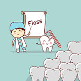 Tandläkaren undervisar tandbruksfloss Arkivfoton