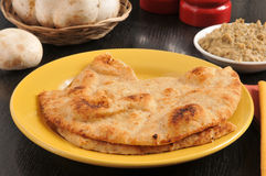 Tandoor baked naan bread Stock Images