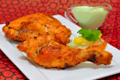 Tandoori Chicken. Chicken Tandoori is a highly popular Indian dish consisting of roasted chicken, yogurt, and spices Royalty Free Stock Image