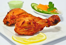 Tandoori Chicken. Chicken Tandoori is a highly popular Indian dish consisting of roasted chicken, yogurt, and spices