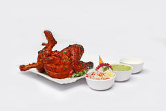 Tandoori Chicken. Is a dish originating from Indian subcontinent. It is widely popular in South Asia, Middle Eastern and Western countries royalty free stock image