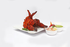 Tandoori chicken. Is a dish originating from Indian subcontinent. It is widely popular in South Asia, Middle Eastern and Western countries. It consists of Stock Photography
