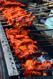 Tandoori Chicken on a grill. Chicken Tandoori is a highly popular Indian dish consisting of roasted chicken, yogurt, and spices.This is from Lucknow Royalty Free Stock Photos