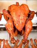 Tandoori chicken grilled. Tandoori chicken displayed on metal grille Royalty Free Stock Image