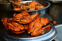 Tandoori Chicken on a plate. Chicken Tandoori is a highly popular Indian dish consisting of roasted chicken, yogurt, and spices Stock Photos