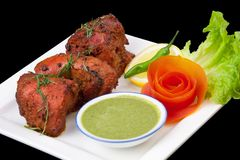Tandoori Chicken with a salad Stock Photo