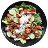 Tandoori Chicken Salad Top View Isolated. Tandoori chicken salad, top view on black plate isolated on white Stock Images