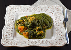 Tandoori chicken with spinach palak style. On a white dish Stock Image