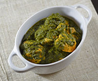 Tandoori chicken with spinach palak style. On a white pot Stock Photos