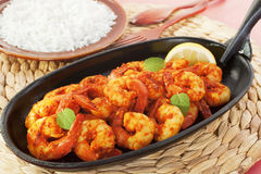Tandoori Prawns Shrimp Indian Curry. Tandoori prawns on a cast iron sizzle platter, served with basmati rice Royalty Free Stock Photography