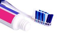 Tandpasta en tandenborstel Stock Foto