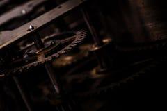 Tandraderen in oude klok Stock Afbeelding