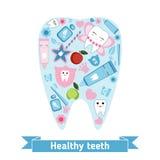 Tandvårdsymboler i formen av tanden Arkivbild