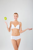 Taned happy fit woman. Diet, healthy lifestyle and body care con Stock Images