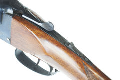 Tang mounted safety. Safety on the tang of a double barreled shotgun isolated on whiteq Royalty Free Stock Photos