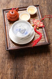 Tang Yuansweet dumplings filled with black sesame. Tang Yuansweet dumplings filled with black sesame and teapot on wooden table. Traditional cuisine for lantern stock images