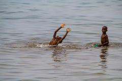 Tanganyika kids swimming in the lake. Burundi Royalty Free Stock Photography