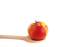 Tangelo on a wooden spoon Stock Images